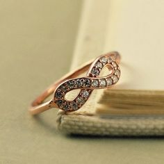 Infinity Ring, Rose Gold Vermeil Sterling Silver, Dainty Ring, Classic Everyday, Elegant, Classic, Cubic Zirconia Ring, Bridal, Wedding. $29.00, via Etsy.