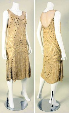 Evening dress ca. 1920s. Beige silk crepe chiffon covered with beads in geometric pattern. Scoop neck, sleeveless, no closures. Lined. Regeneration/1st Dibs