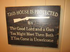 "Primitive Decor Wood Sign: ""This house is protected by....."" Distressed Rustic"