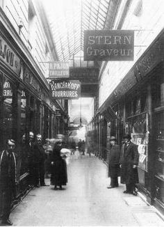 """Passage des Panoramas, Paris 1910. """"The Passage des Panoramas is a roofed commercial passageway located in the IIe arrondissement, of Paris between the Montmartre boulevard to the North and Saint-Marc street to the south. It is one of the earliest venues of the Parisian philatelic trade, and it was one of the very first covered, airy commercial passageways in the world. """""""
