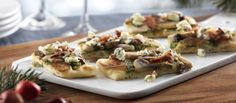 Blue Cheese,Pesto & Mushroom Appetizer Recipe Appetizers with Stonefire Tandoori Original Naan, basil pesto sauce, olive oil, blue cheese, sliced mushrooms, cooked bacon, fresh basil leaves, grated parmesan cheese, extra-virgin olive oil, garlic cloves, salt