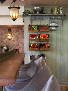Crates on the wall to store produce, liberate counter top space and see the ingredients you have available for dinner.