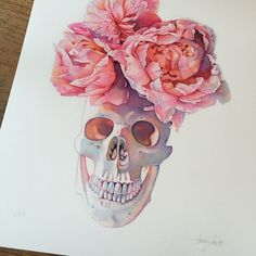 not a big skull fan, but love the flower arrangement