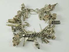 Charm Bracelet with Thirty Two Charms 7 long by AntiqueJewellers