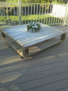 I was originally Pinspired to do a pallet table like this and add a rain gutter down the middle to serve as a drink well/flower box (when not being used for drink well)...but my husband thought boarded sections from a fence we took down instead. And he was clever enough to think that a bucket would be easier to fill/drain than the gutter idea, so he cut out the center for a bucket (1 bucket for flowers, which we will take out to use the other bucket for ice/drinks when needed!). i~Love~THIS!