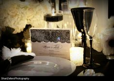 The theme of our table is inspired by the motion picture, The Black Swan. The tablescape is a combination of modern and monochromatic with hints of French influence as a nod to the ballet. The elements will emulate the two personas by combining the elegance, innocence, and grace of the white swan with the anchor of guile and sensuality embodied by the Black Swan.