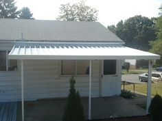 Crest 700 Flat Pan Aluminum Awning in White.