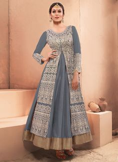 This grey silk and net designer gown is adding the beautiful glamorous displaying the sense of cute and graceful. You could see some intriguing patterns carried out with embroidered and resham work. (...