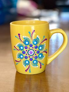 Your place to buy and sell all things handmade Excited to share this item from my shop: Coffee cup/mug dot mandala 12 oz hand painted Yellow, turquoise, purple, white Painted Coffee Mugs, Hand Painted Mugs, Painted Cups, Dot Art Painting, Mandala Painting, Pottery Painting, Yellow Cups, Painted Flower Pots, Using Acrylic Paint