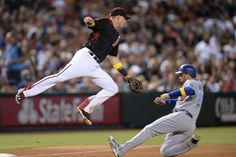 Dodging Lamb:     The Dodgers' Adrian Gonzalez reaches third base safely after a throw gets away from the Diamondbacks third baseman Jake Lamb on Sep. 17 in Phoenix. The Dodgers won 6-2.