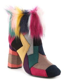 Vibrant faux fur and contrasting color blocks lend playful flair to this eye-catching ankle boot boasting a comfy textile lining.