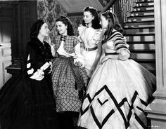 Ellen OHara (Barbara ONeil) talks to daughters Careen (Ann Rutherford), Scarlett (Vivien Leigh) and Suellen (Evelyn Keyes) in an early scene in Gone with the Wind.