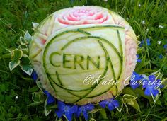 Cern logo carving melone decoration by Katie Carving Geneva Geneva, Carving, Fruit, Decoration, Decor, Wood Carvings, Sculpting, Deko, Dekoration