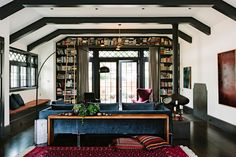 everything in this pic: shelves, ladder, french doors, blue velvet couch, hardwood floors.. perfection
