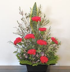 Designs For Garden Flower Beds Carnations With A Mother In Laws Tongue Leaf With Wax Flowers And Some Fir. Wax Flowers, Table Flowers, Fresh Flowers, Beautiful Flowers, Church Flower Arrangements, Church Flowers, Floral Arrangements, Corporate Flowers, Altar Decorations