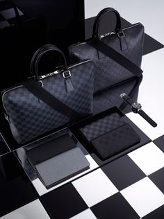 Subtly elegant, decisively contemporary, infinitely versatile:  the classic Louis Vuitton Damier design perfect in black for those with unique style.