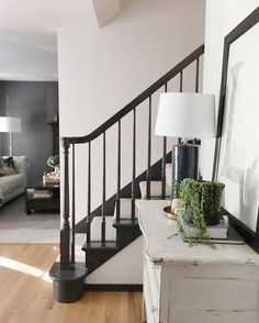 Love the black staircase with the white carpet runner. Such a bold color to have on the stairs, but looks fabulous with the white room! Add other black accent items to the room to tie everything together. Black Staircase, Staircase Design, Black Banister, Farmhouse Style, Farmhouse Decor, Moroccan Table Lamp, Home Interior, Interior Design, Jones Design Company