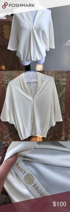 Gorgeous Ramy Brook 100% Silk Blouse This beautiful Silk Blouse is unique, sexy, classy and has JUST been dry cleaned. Great condition. No damages. Good as new. Flowey, breathable, Spacious. One size fits all. But best fits a M-L. Ramy Brook Tops Blouses