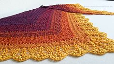 """Erigeneia means """"Early-born"""" and is an epithet to the greek goddess Eos - the goddess of the Dawn. Worked in that lovely gradient yarn I couldn't help but think of a sunrise. That's where the shawl got its name from :-)"""