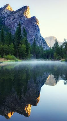First light on Three Brothers in Yosemite National Park, California • photo: Andrew Mace on Flickr