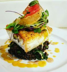 """Dinner On The Deck"""" Pan seared Halibut over warm Beluga lentils and wilted kale.Topped with Brussel leaves,watermelon and grapefruit segment micro salad and a pablano mango buerre blanc. Paired with A Sauvignon Blanc Entree Recipes, Top Recipes, Fish Recipes, Gourmet Recipes, Cooking Recipes, Weird Food, Food Is Fuel, Halibut, Sauvignon Blanc"""