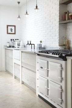 pale grey wood cabinets and white brick // kitchen