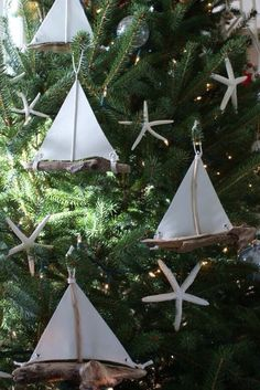 Coastal Christmas. Need some of these driftwood sailboats for my tree
