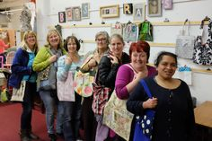 Our Friday volunteer Upcycling Group showing off a selection of the shopping bags they made using a variety of pre-loved and new fabrics.