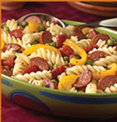 Franks Grilling Recipes - Hearty Pasta Dinner Salad Recipe - Hebrew National ~ A colorful main dish pasta salad combining sliced Hebrew National® beef franks, yellow peppers, peas, and tomatoes tossed with vinaigrette and served warm. Yummy Pasta Recipes, Salad Recipes For Dinner, Dinner Salads, Dessert Recipes, Meal Recipes, Pork Recipes, Pasta Dishes, Food Dishes, Slow Cooker Pasta