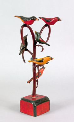 """Realized Price: $ 70,200 """"Schtockschnitzler"""" Simmons(Berks County, Pennsylvania, active 1885-1910), carved and painted bird tree with seven polychrome decorated birds, 15"""" h. Illustrated in Machmer, Just For Nice, frontspiece. RICHARD MACHMER COLLECTION 2008"""