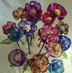 flor de garrafa pet flor garrafa pet reciclada,madeira,continhas garrafa pet queimada,pintura com tinta vitral