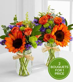 orange tinted sunflowers, orange spray roses, purple statice, yellow solidago, and green button poms