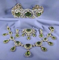 A famous example is Archduchess Isabella's Diamond and Peridot Tiara and Peridot Parure. The tiara is made with some enormous, apricot-sized, peridots, surrounded by diamonds and was made in the 1820's by the Hapsburg Imperial Jeweler Kőchert. These jewels showed up for auction in 2001 after sitting in a California bank vault for over 50 years!