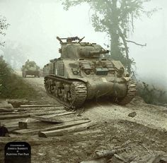 A Sherman Tank and (what looks like) a Humber Armoured Car sit on a foggy hilltop road, waiting for the call to advance during the Final Battle for Monte Cassino. Cassino, Italy, 13th May, 1944. Monte Cassino was a hilltop Abbey situated less than 2 kilometres to the west of the town of Cassino which dominated the entrance to the surrounding Liri valley. The effectiveness and pinpoint accuracy of the artillery encountered by the advancing Allied forces lead them to believe that the Germa...