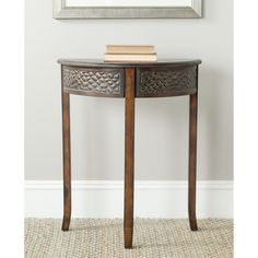 Add an elegant accent to your entryway with this lovely birchwood console table from Safavieh. This delightful structure not only provides style to your home, but also gives you an extra surface on which to set down keys and other items.