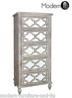 Finished in a washed wood effect this beautiful chest of 4 drawers has a lovely wooden pattern on the front Behind that is a lovely mirrored panel