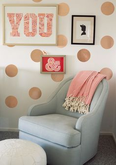 metallic polka dot wall behind changing table?  Could do with iron on fabric decals that remove easily!  nurseries - YOU Print - One Point Oh Girl Silhouette from Keep Calm Gallery DwellStudio Savoy Glider Nursery Chair Serena & Lily White Moroccan Leather Pouf Serena & Lily Coral Herringbone throw diy gold dots