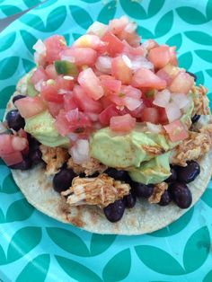 "My favorite 21 Day Fix meal so far. Toastada: 1 corn tortilla crisped in a frying pan, no oil just heat until crispy. 1/2 a yellow container of black beans. 1/2 a red container of skinless boneless chicken breast cooked in the crock pot with Mexican seasoning. 1/2 green container of Trader Joe's fresh pico de gallo. and top it off with ""guilt free gauc"" 1/2 red of plain greek yogurt food processed with 1 blue of avocado and fresh lime juice. =1 red, 1 yellow, 1/2 green, 1 blue. ‪#‎21DF‬X"