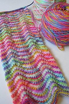 For multicolor yarn that speckles instead of stripes: Alternate a dark and a light. Here, a Chevron Scarf: Two distinctly different hand dyed yarns alternated