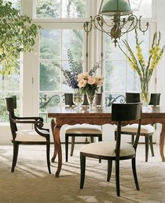 Classic Dining Room style  Classic dining table, black dining chairs and windows