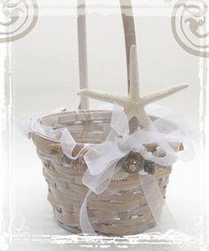 By The Shore. A Flowergirl Basket Decorated With White Starfish Decoration Weddings. Beach Coastal Ocean Sea Wedding Decor. $25.00, via Etsy.