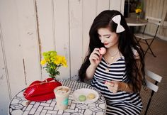 Yummy macarons and an adorable striped dress with lace accents. Noelle Downing looks adorable.