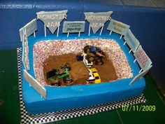 Monster Truck Birthday Cake - Took this idea from a CCer thank-you.  Amazing chocolate WASC cake with white chocolate B/C, accents all gumpaste, (cars from my son's collection)