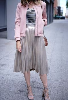 Pink bomber jacket paired with a metallic Zara pleated skirt.
