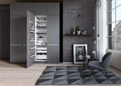 Cool grays paint this urban loft. Clean, simple organization by SieMatic.