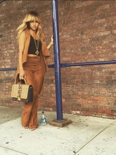 Karrueche Tran's New York Fashion Week La Marque Brown Suede Elem Vest and the High Waisted Pants