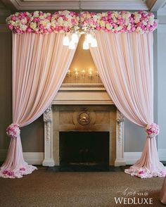 Pretty in pink is the best way we can describe this ceremony design- the soft draping in blush instantly evokes a feminine, romantic vision!   Photography By: Melia Lucida Photographer.   WedLuxe Magazine   #Wedding #luxury #weddinginspiration #luxurywedding #ceremony #pink #blush #weddingcolours #altar #floral #decordesign #eventdesign #decor