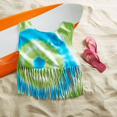 Keep the summer alive with a fun Tie Dye Fringe T-Shirt.