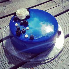 Chocolate fudge layer cake with blue mirror glaze
