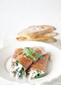 Parma ham with celeriac remoulade: Parma ham encases capers, rocket and celeriac rémoulade, a French condiment similar to tartar sauce. Ideal as a light, no-cook, simple appetiser